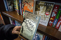 "A reader holds a paperback copy of ""To Kill a Mockingbird"" by Harper Lee in a bookstore in New York on Wednesday, February 4, 2015. The famed Pulitzer Prize winning author will release her second novel, ""Go Set A Watchman"", a sequel to Mockingbird published 50 years ago. Watchman was actually written prior to Mockingbird and was recently found after being thought lost. The book will be released July 14. (© Richard B. Levine)"