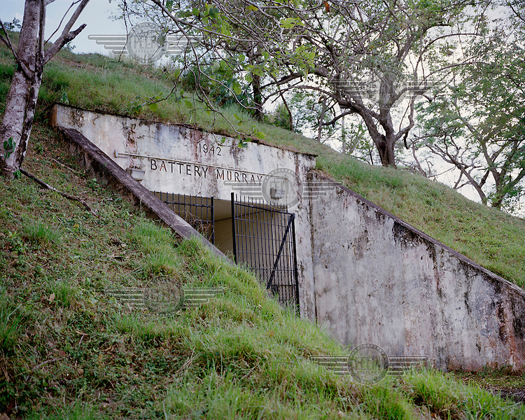 An old army bunker built in 1942 at Fort Sherman, a former United States Army base located on Toro Point at the Atlantic (northern) end of the Panama Canal. It was the primary defensive base for the Atlantic sector of the Canal, and was also the centre for US Jungle Warfare training.  <br /> The Panama Canal Zone is an area extending 8kms out, in each direction, from the waterway's central line, was a territory controlled by the United States between 1903 and 1979. After a 20 year period of joint administration, the Canal came under the full control of Panama in 1999. The Canal opened to shipping in 1914 and during its tenure was of great strategic importance to the US, enabling it to rapidly move its naval fleet between the Atlantic and Pacific Oceans. However, its economic value came not directly from shipping fees but from the stimulus to trade that the waterway created. One hundred years after it opened in 2014 it is due to have its locks upgraded to cater for the super sized container ships of the 21st Century.  <br /> During the era of American administration thousands of US citizens populated the Canal Zone, living and working under US law in towns built to American standards. Not all of these people returned north after the canal came under full Panamanian control many stayed on, their identities tied to the region.