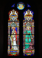Stained glass window of St Anne teaching the Virgin and St Michael by Julien Leopold Lobin, 1814-64, installed 1855, in the Royal Chapel, on the second floor of the Phare de Cordouan or Cordouan Lighthouse, built 1584-1611 in Renaissance style by Louis de Foix, 1530-1604, French architect, located 7km at sea, near the mouth of the Gironde estuary, Aquitaine, France. This is the oldest lighthouse in France. There are 4 storeys, with keeper apartments and an entrance hall, King's apartments, chapel, secondary lantern and the lantern at the top at 68m. Parabolic lamps and lenses were added in the 18th and 19th centuries. The lighthouse is listed as a historic monument. Picture by Manuel Cohen