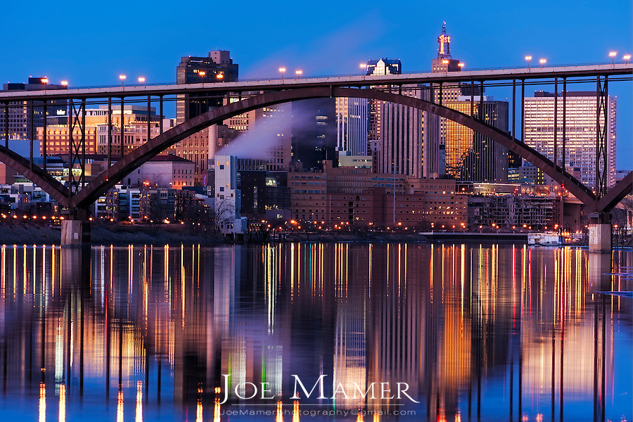Saint Paul, Minnesota skyline at dusk with the Smith Ave High Bridge in the foreground.