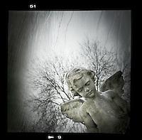 Stone cherub memorial