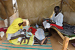 A family in the Dereig Camp for internally displaced persons, one of many such settlements for people displaced by the violence in Darfur.