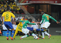 Ivory Coast's Ismael Tiote tackles Brazilian midfielder Kaka. Brazil defeated Ivory Coast, 3-1, in an important Group G match, Sunday, June 20th, at Soccer City Stadium in Johannesburg..