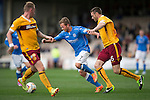 Motherwell v St Johnstone...30.08.14  SPFL<br /> Chris Millar gets between Stephen McManus and Craig Reid<br /> Picture by Graeme Hart.<br /> Copyright Perthshire Picture Agency<br /> Tel: 01738 623350  Mobile: 07990 594431