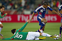 Ricardo Osorio (L) Mexico slides in to Florent Malouda of France