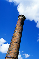 Brick smoke stack emitting smoke, Vienne, France.