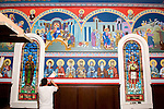 Slobodan Kikovich paints the border beneath the Icons painted by Miloje Milinkovic iconographer inside St. Sava Serbian Orthodox Church, Jackson, Calif.
