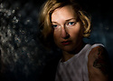 Portrait of a woman in a dark setting