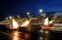 Feb. 19, 2010; Chandler, AZ, USA; NHRA top fuel dragster driver Cory McClenathan (left) races alongside Troy Buff during qualifying for the Arizona Nationals at Firebird International Raceway. Mandatory Credit: Mark J. Rebilas-