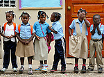 Children line up at school in Batey Bombita, a community in the southwest of the Dominican Republic whose population is composed of Haitian immigrants and their descendents.