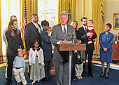 United States President Bill Clinton announces a proposed new rule that will allow the states to use their unemployment compensation systems to help offer paid leave to new parents in the Oval Office of the White House in Washington, DC on 30 November, 1999.<br /> Credit: Ron Sachs / CNP