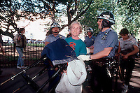 NYPD officers evict the homeless and other squatters from Tompkins Square park in the East Village on June 3, 1991. (© Frances M. Roberts)