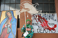 "Phoenix, Arizona - Arturo Malvido Conway, dressed to represent ""the tree of life stripped off its leaves by the violence in Mexico,"" stands holding a white woven dove as a symbol of peace and next to a banner denouncing 50 thousand deaths as a result of the drug war. Malvido arrived to Downtown Phoenix from California to be part of a rally and vigil at the Civic Space Park. While Malvido's brother, Rafael Malvido Conway, was murdered 14 years ago in Mexico City, his death remains unsolved. His nephew David Romero was also murdered in the state of Michoacán. Malvido joined the ""Caravan for Peace with Justice and Dignity"" to share his sorrow with others whose relatives were killed or are missing. The ""Caravan for Peace with Justice and Dignity"" stopped in Phoenix on Wednesday, August 15, 2012 as it travels across the United States as a way to create awareness in the United States about the failed drug war in Mexico that has left more than 70,000 dead. The caravan is led by Mexican poet, essayist, novelist, and journalist Javier Sicilia, whose son Juan Francisco Sicilia Ortega son was brutally murdered along with six other students in Morelos, Mexico by members of a drug cartel on March 28, 2011. In response, Sicilia created the Movement for Peace with Justice and Dignity --popularly known as ¡Ya Estamos Hasta la Madre! or We Have Had It!-- calling for an end the drug cartels bloodshed. Photo by Eduardo Barraza © 2012"