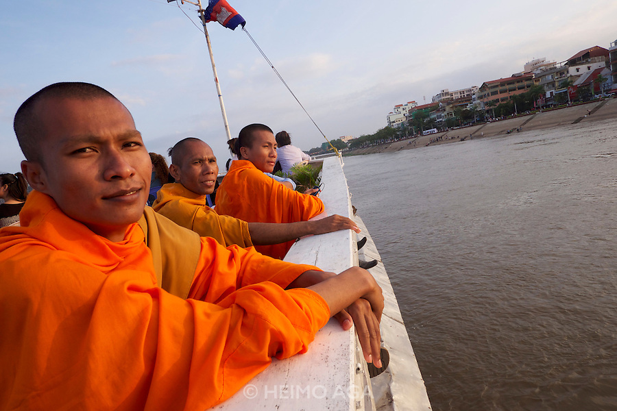 Phnom Penh, Cambodia. Sunset cruise to the confluence of Tonle Sap and Mekong river.<br /> Buddhist monks.