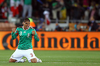 Carlos Salcido of Mexico celebrates his sides win against France
