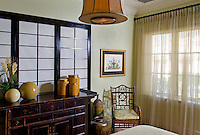 Asian influenced bedroom with Shoji screen creates a unique backdrop for the dresser