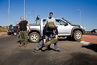 Sderot, Israel, Jan 06, 2009.Israeli security personel pick up a Kassam rocket fired moments before from Jabalya in the gaza strip. After several weeks of total closure, Israel has launched its most important military operation ever in the Gaza strip, following Hamas' refusal to extend the 6 months truce.
