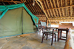 Cozy and nicely appointed tent lodging O at Southern Cross safari tent camp in Tsavo  East National Park, Kenya