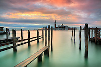 A flaming sunrise over San Giorgio Maggiore in Venice, Italy. Taken about 10 minutes before dawn from the quay of Riva degli Schiavoni on a morning at the beginning of December