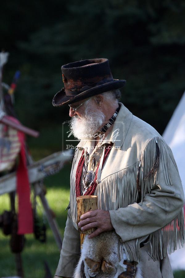 A buckskinner man in camp