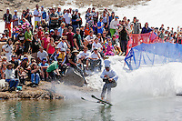 """Cushing Classic at Squaw Valley 13"" - Photograph of a skier crossing a pond during the Cushing Classic at Squaw Valley, USA."