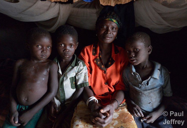 Asanta Jantana sits in a earthen-walled house in Kotobi, South Sudan, along with three of her children. They are among hundreds of thousands of people who were displaced by political violence that broke out in December 2013 and quickly fractured regions of the young nation along ethnic and tribal lines. Jantana fled Juba with her seven children for this village, where she moved in with a brother. Yet she hasn't had enough food for her whole family, so she sent four of her children to live with another relative. She hasn't heard from her husband, a soldier, since the fighting began. Finn Church Aid, a member of the ACT Alliance, provided materials for distribution of food and non-food items that benefited Jantana and other displaced people here.