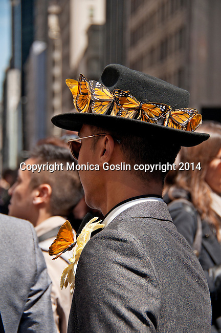 Man wearing a suit and a hat with butterflies all around the brim in the Easter Parade on Fifth Avenue in New York City