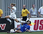 Maren Meinert (6) strips the ball from Rachel Kruze (14) at Nickerson Field in Boston MA on 7/13/03 during a game between the Boston Breakers and Philadelphia Charge. The Breakers won 3-1.