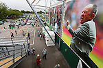 Yeovil Town 0 Queens Park Rangers 1, 21/09/2013. Huish Park, Championship. Fans entering The Agusta Westland Stand beneath a large photograph of manager Gary Johnson celebrating Yeovil's play off win at Wembley in 2013. Photo by Paul Thompson.