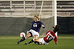 2 November 2005: North Carolina goalkeeper Aly Winget (59) plays the ball away from Maryland's Kaila Sciascia (16).  The players collided on the play - Winget was injured and carted off, and did not return. The University of North Carolina defeated the University of Maryland 3-1 at SAS Stadium in Cary, North Carolina in the quarterfinals of the 2005 ACC Women's Soccer Championship.