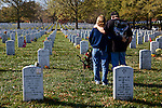 ARLINGTON, VA - NOVEMBER 11: Linda and Gene Lamie, of Georgia, stand before the grave of their son, Sgt. Gene L. Lamie, on Veteran's Day at Arlington National Cemetery on November 11, 2012 in Arlington, Virginia. Sgt. Lamie was killed during Operation Iraqi Freedom in 2007 at the age of 25.