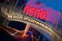 """Downtown Reno 1""  This Reno The Biggest Little City in the World sign, also know at the Reno Arch,  was photographed in Reno, Nevada. The effect was obtained in camera by long exposure mixed with intentional camera movement."
