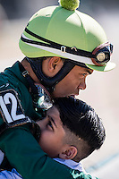 OLDSMAR, FLORIDA - FEBRUARY 11: Sammy Camacho hugs what appears to be his son, after a race, at Tampa Bay Downs on February 11, 2017 in Oldsmar, Florida (photo by Douglas DeFelice/Eclipse Sportswire/Getty Images)