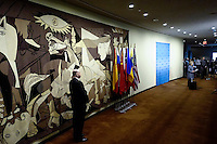 Guernica painting by Pablo Picasso is seen while Former US Secretary of State Hillary Clinton speaks to the media about her personal email account at United Nations Headquarters in New York. 10.03.2015. Eduardo Munoz Alvarez/VIEWpress.