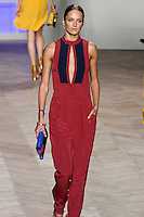 Karmen Pedaru walks the runway in a red/navy silk sleeveless jumpsuit with deep keyhole front, by Tommy Hilfiger for the Tommy Hilfiger Spring 2012 Pop Prep Collection, during Mercedes-Benz Fashion Week Spring 2012.
