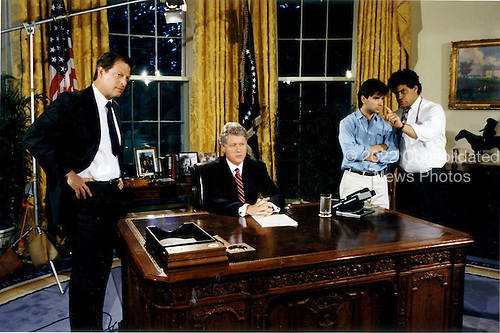 United States President Bill Clinton prepares to address the nation from the Oval Office of the White House in Washington, D.C. on Saturday, June 26, 1993.  He spoke on the successful bombing of Iraq earlier in the day.  Pictured from left to right: Vice President Al Gore, President Clinton, Communications Director George Stephanopoulos, and Steve Rabinowitz..Credit: White House via CNP