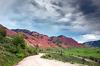 Winding road, Red Hills of the Gros Ventre River Valley, thunderstorm, Jackson Hole, Wyoming