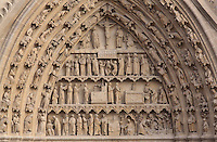Tympanum of the South or St Honore portal, with (top - bottom) the crucifixion of Christ, procession of the relics of St Firmin, St Honore at mass and performing healing miracles, discovery of the bodies of saints Fuscian, Victoricus and<br /> Gentian, the coronation of St Honore and the apostles, on the South transept of the Basilique Cathedrale Notre-Dame d'Amiens or Cathedral Basilica of Our Lady of Amiens, built 1220-70 in Gothic style, Amiens, Picardy, France. St Honore or Honoratus was the 7th bishop of Amiens who lived in the 6th century AD. Amiens Cathedral was listed as a UNESCO World Heritage Site in 1981. Picture by Manuel Cohen