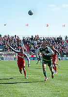 26 March 2011: Portland Timbers defender Steve Purdy #25 and Toronto FC defender Ashtone Morgan #5 in action during an MLS game between the Portland Timbers and the Toronto FC at BMO Field in Toronto, Ontario Canada..Toronto FC won 2-0....