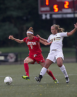 Boston University defender Erin Mullen (7) attempts to control the ball as Boston College forward/midfielder Rachel Davitt (24) defends. After 2 complete overtime periods, Boston College tied Boston University, 1-1, after 2 overtime periods at Newton Soccer Field, August 19, 2011.