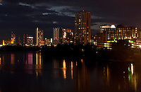 Skyline of Austin, TX, state capitol with Colorado River and riverboat in foreground