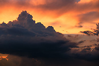 Commercial Airliner approaching a large storm at sunset near Manila, Philippines