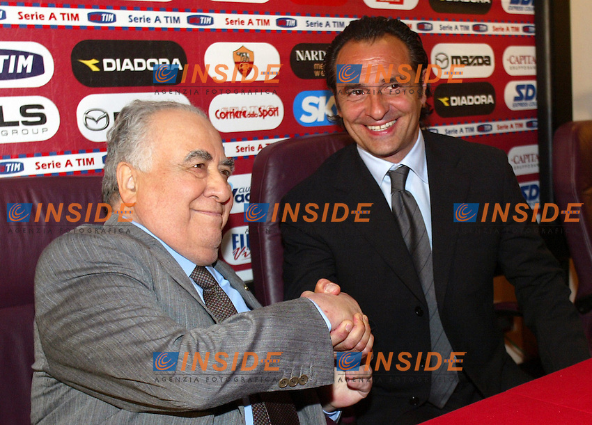 Roma 1/6/2004 <br /> Il nuovo allenatore della Roma Cesare Prandelli stringe la mano al Presidente Franco Sensi durante la conferenza stampa di presentazione a Trigoria.<br /> <br /> A.S. Roma's new coach Cesare Prandelli (R) shakes hands with his president Franco Sensi at the Trigoria training ground on the outskirts of Rome June 1, 2004. AS Roma have appointed Parma's Cesare Prandelli as their new coach replacing Fabio Capello who walked out to join Juventus on Friday<br /> Photo Insidefoto Andrea Staccioli