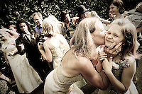 A flower girl gets a big smootch during the reception following Kari and Justin's Seattle home wedding. (Photo by Andy Rogers/Red Box Pictures)