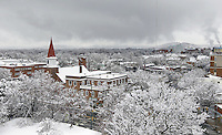 A westward view overlooking West Main Street and Ridge Street covered in a late spring snow fall located in Downtown Charlottesville, VA. Photo/Andrew Shurtleff