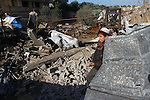 A Palestinian boy walks on debris of houses destroyed during an Israeli air strike, near the Nuseirat refugee camp in central Gaza Strip on Jan. 2, 2011. Photo by Ashraf Amra