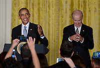 United States President Barack Obama (L) speaks as Vice President Joe Biden  looks on during a reception for Hispanic Heritage Month in the East Room of the White House on October 12, 2016 in Washington, DC. <br /> Credit: Olivier Douliery / Pool via CNP /MediaPunch