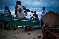 Some Bajau have a rest after dinner