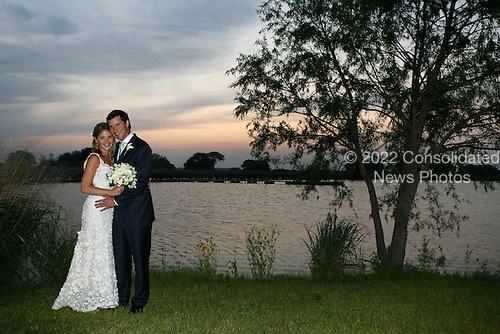 Jenna Bush Hager and Henry Hager pose for photographs along the lake at Prairie Chapel Ranch following their wedding ceremony Saturday, May 10, 2008, in Crawford, Texas. .Mandatory Credit: Shealah Craighead / White House via CNP.