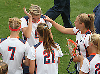 The University of Virginia women's lacrosse players console Molly Millard, top middle, as she gets emotional before the start of their first game since the death of teamate Yeardley Love Sunday May 16, 2010 at Klockner Stadium in Charlottesville, Va. The Cavaliers rallied in the last four minutes to beat Towson 14-12 and reach the quarter finals of the NCAA tournament. Love's body was found May 3, and Virginia men's lacrosse player George Huguely is charged with murder. Photo/Andrew Shurtleff..